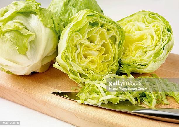 Iceberg lettuce, partly sliced into strips