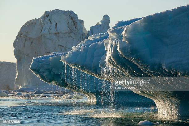 iceberg melting in disko bay in greenland - greenland stock pictures, royalty-free photos & images