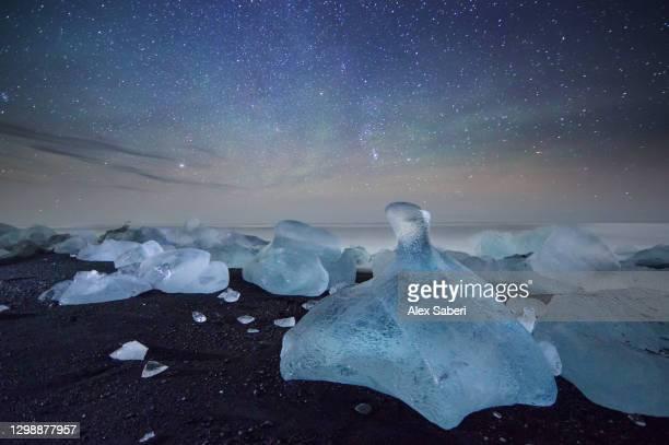 iceberg on a black beach. - alex saberi stock-fotos und bilder