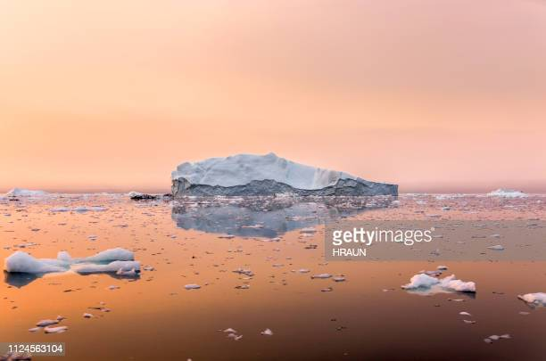 iceberg on beautiful sea in the sunset - global warming stock pictures, royalty-free photos & images