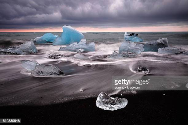 Iceberg on black sea beach at Jokulsarlon;Iceland