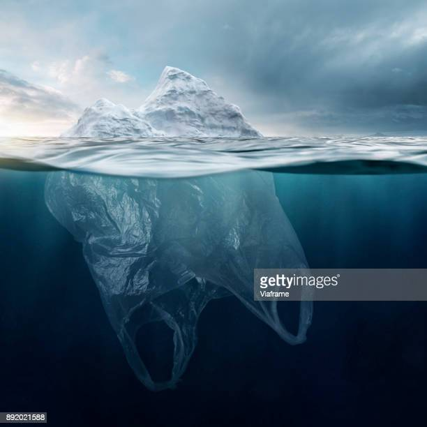 iceberg plasticbag - greenpeace stock pictures, royalty-free photos & images