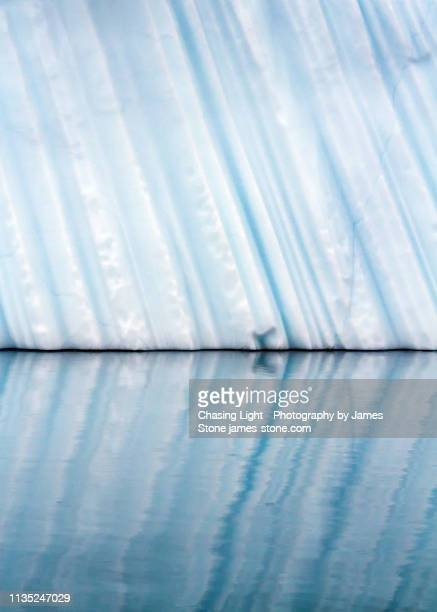 iceberg reflection - iceberg ice formation ストックフォトと画像