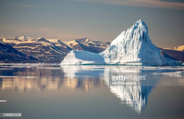 iceberg reflections - berg stock pictures, royalty-free photos & images