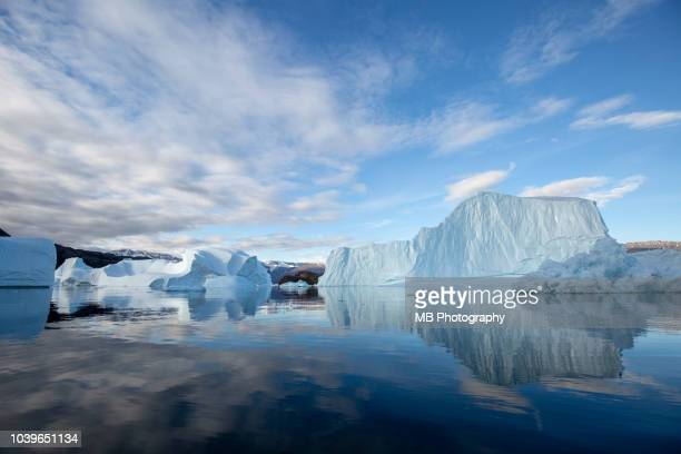 iceberg shapes and reflections - north pole stock pictures, royalty-free photos & images