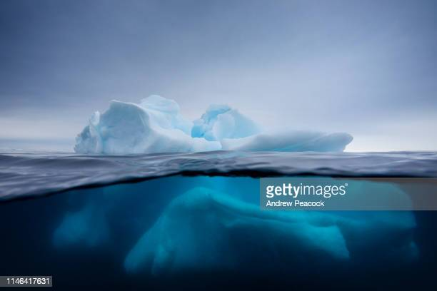 iceberg under and over water - berg stock pictures, royalty-free photos & images