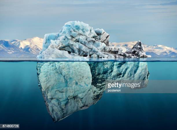 iceberg with above and underwater view - climate stock pictures, royalty-free photos & images