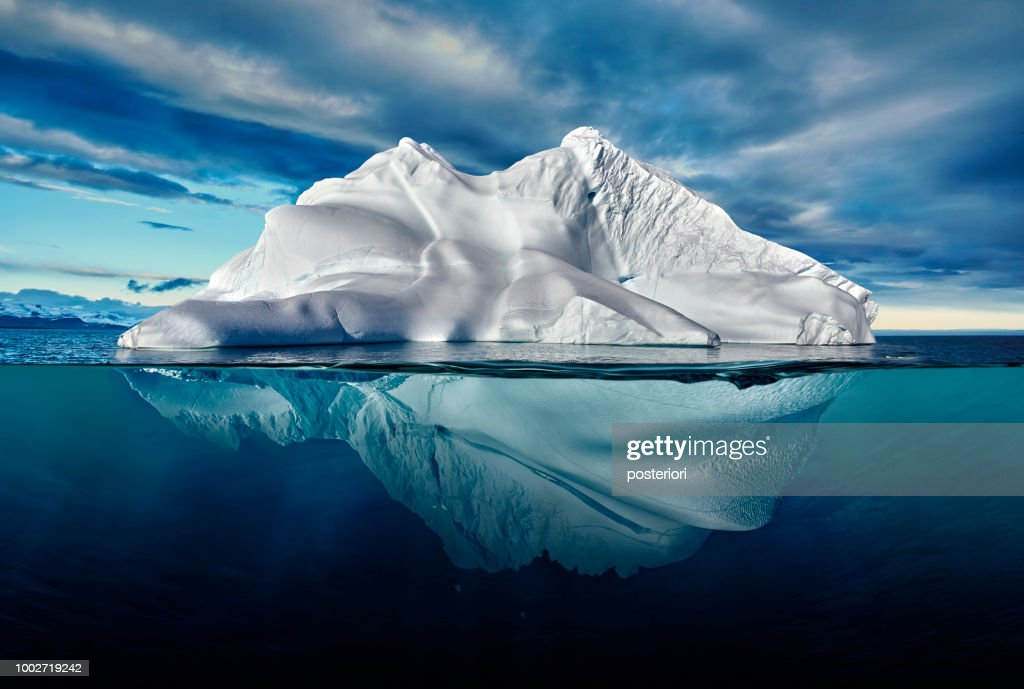 iceberg with above and underwater view taken in greenland. : Stock Photo