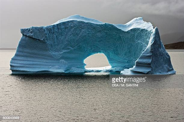 Iceberg with arch off the west coast of Greenland Denmark