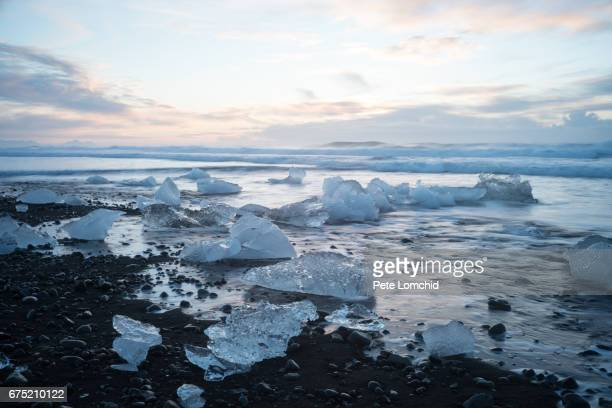 Icebergs and blocks of ice on the black sand beach in southern Iceland.