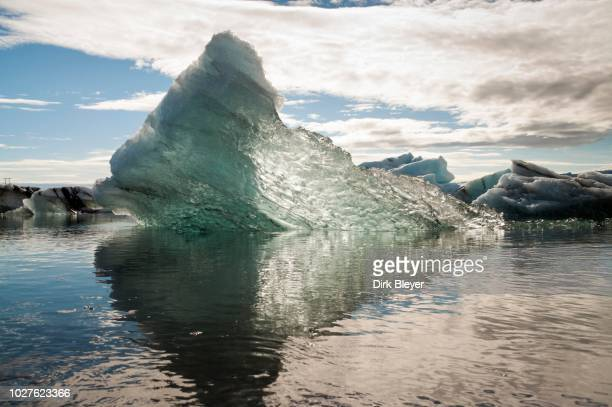 icebergs and ice crystals reflected on the glacier lagoon of joekulsarlon, vatnajoekull glacier, austurland, east iceland, iceland - austurland stock pictures, royalty-free photos & images