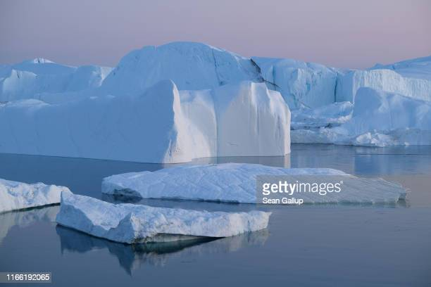 Icebergs and ice float in the Ilulissat Icefjord on August 04, 2019 near Ilulissat, Greenland. The Sahara heat wave that recently sent temperatures...
