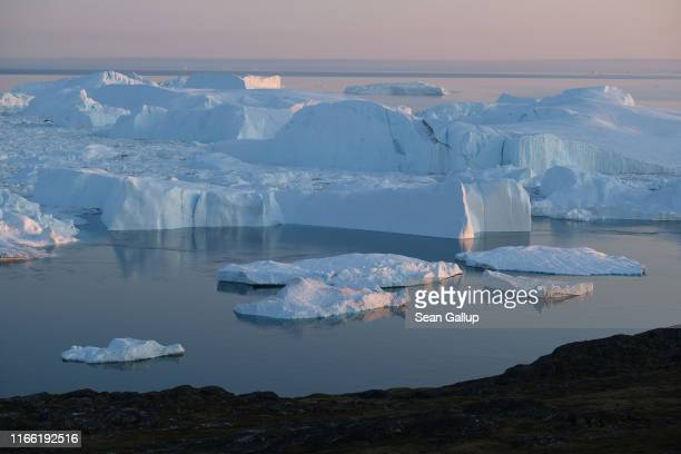 Icebergs and ice float in the Ilulissat Icefjord on August 04 2019 near Ilulissat Greenland The Sahara heat wave that recently sent temperatures to...