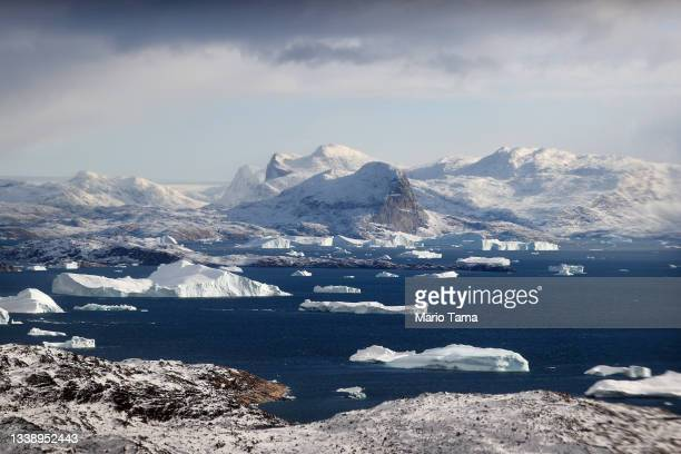 Icebergs are seen from NASA's Oceans Melting Greenland research aircraft on September 7, 2021 near Upernavik, Greenland. The NASA Oceans Melting...