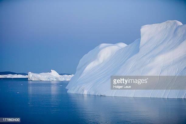 Icebergs at dusk