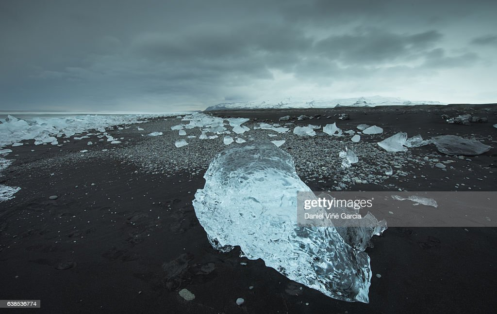 Icebergs at sunset at Jökulsárlón Glacier lagoon on the black sand beach, Iceland. : Stock Photo