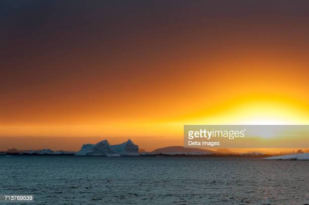 Icebergs at sunset in Lemaire channel, Antarctica