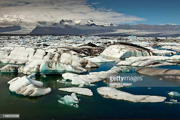icebergs carved from breidamerkurjokull in jokulsarlon glacial lagoon. - breidamerkurjokull glacier stock photos and pictures