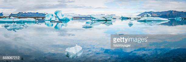 Icebergs drifting in blue Arctic Ocean lagoon glaciers panorama Iceland