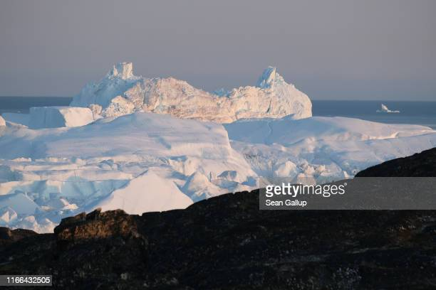 Icebergs float at the mouth of the Ilulissat Icefjord during a week of unseasonably warm weather on August 4 2019 near Ilulissat Greenland The Sahara...