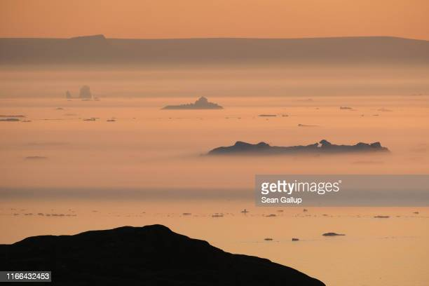 Icebergs float in Disko Bay at sunset on August 04 2019 near Ilulissat Greenland The Sahara heat wave that recently sent temperatures to record...