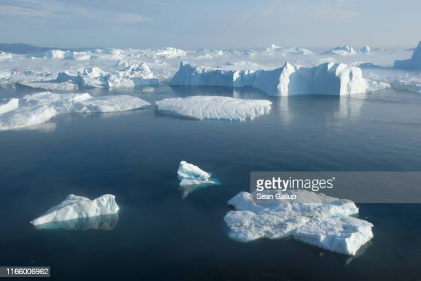 Icebergs float in the Ilulissat Icefjord during a week of unseasonably warm weather on August 3 2019 near Ilulissat Greenland The Sahara heat wave...