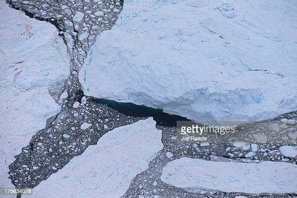 Icebergs float in the water on July 17 2013 in Ilulissat Greenland As Greenlanders adapt to the changing climate and go on with their lives...