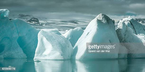 icebergs floating in a glacier lagoon - breidamerkurjokull glacier stock photos and pictures