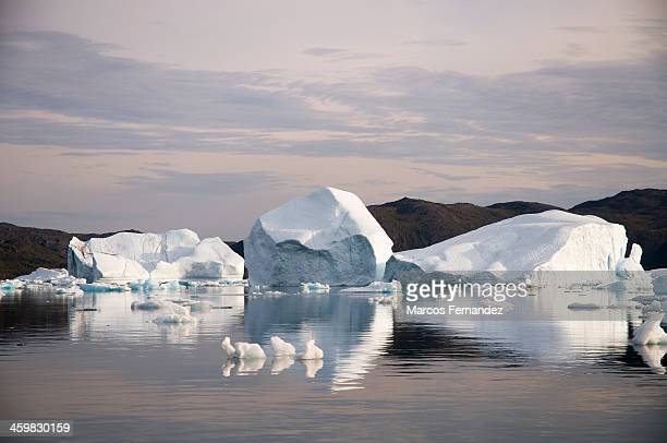Icebergs floating in front of Narsaq village. The people from Narsaq started to watch his harbour without ice in summer from just 10 years ago.