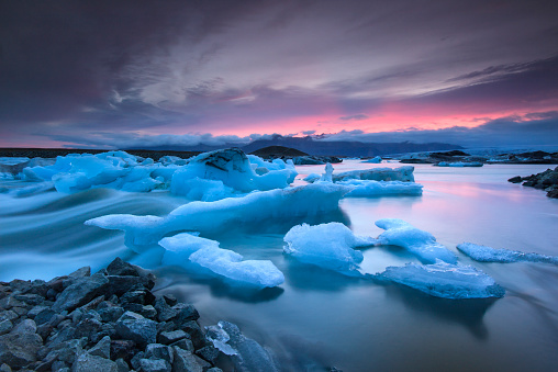 Icebergs floating in Jokulsarlon glacier lake at sunset 469365962