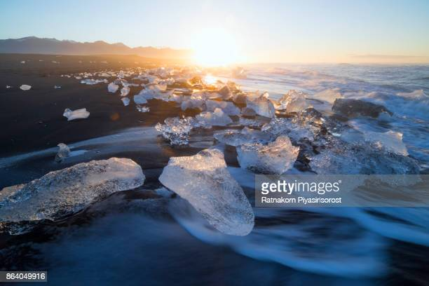 Icebergs Floating on Icy Beach at Sunrise, South Iceland