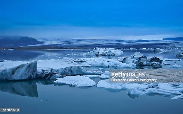 icebergs floating on jokulsarlon lagoon, iceland - breidamerkurjokull glacier stock photos and pictures