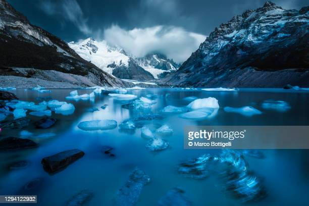 icebergs floating on laguna torre, patagonia argentina - argentina stock pictures, royalty-free photos & images