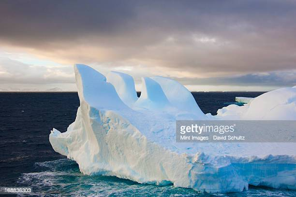 icebergs floating on the antarctic southern oceans. eroded by wind and weather, creating interesting shapes.  - weddell sea stock photos and pictures