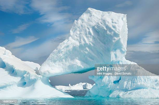 icebergs floating on the antarctic southern oceans. eroded by wind and weather, creating natural ice arches. - weddell sea fotografías e imágenes de stock