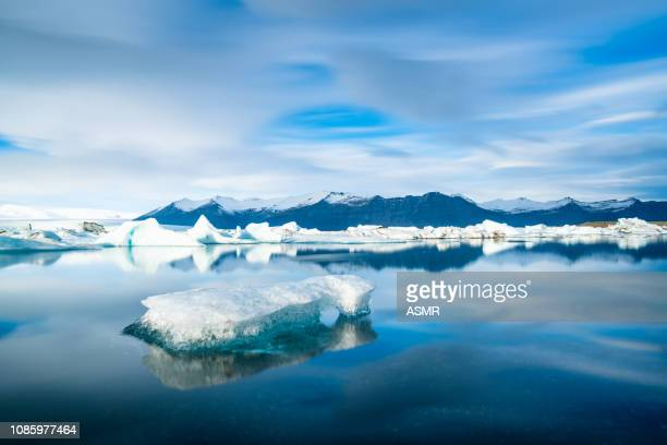 icebergs floating on the beach iceland - glacier lagoon stock photos and pictures
