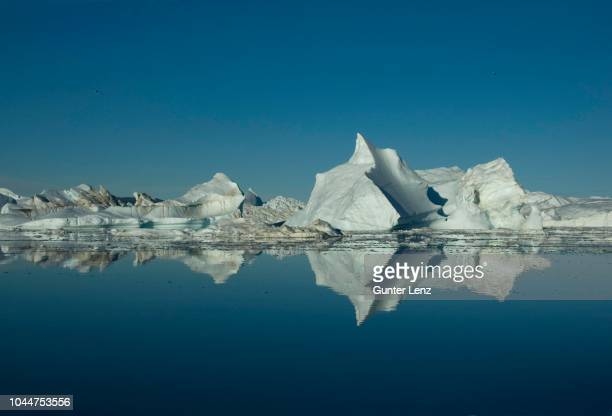 icebergs, greenland, kangia icefjord - ilulissat stock-fotos und bilder