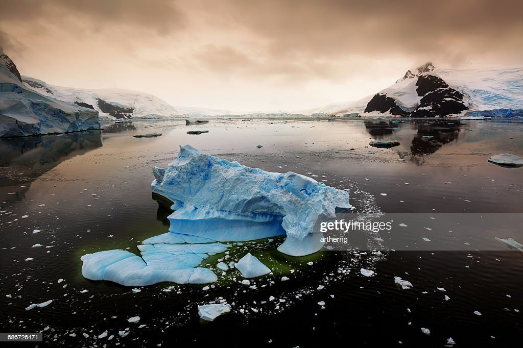 Icebergs in Lemaire Channel at sunset, Antarctica : Stock Photo