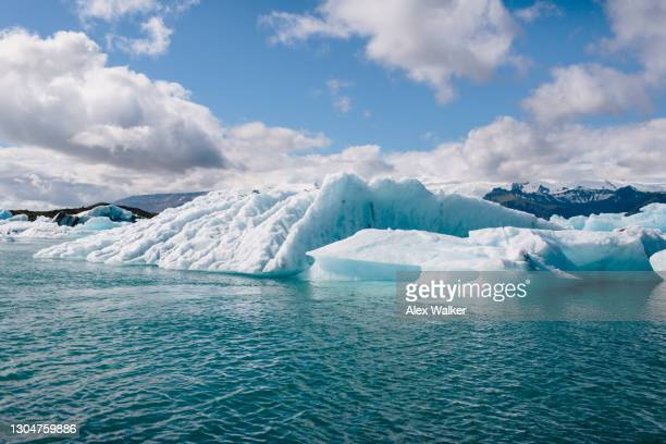 icebergs in the jökulsárlón glacial lagoon - ice floe stock pictures, royalty-free photos & images