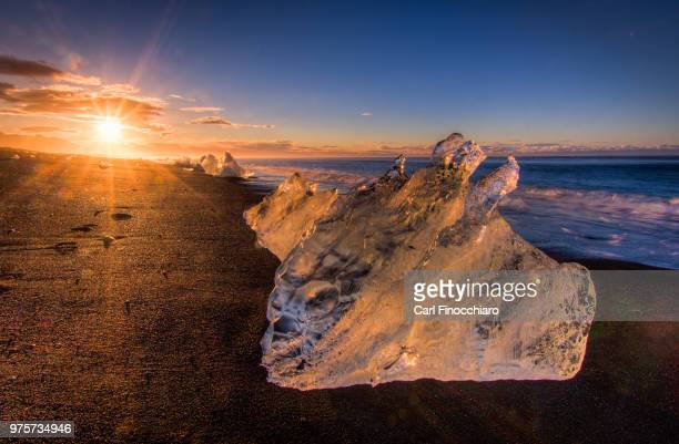 icebergs on shore of jokulsarlon glacier lagoon, iceland - glacier lagoon stock photos and pictures