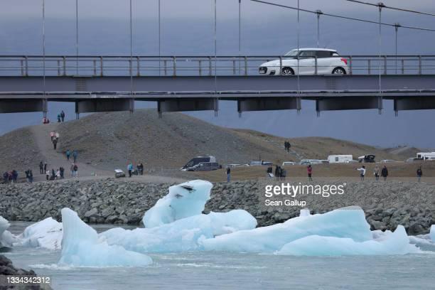 Icebergs that have broken off of receding Breidamerkurjokull glacier clog a river leading from Jokulsarlon lake to the ocean on August 15, 2021 near...