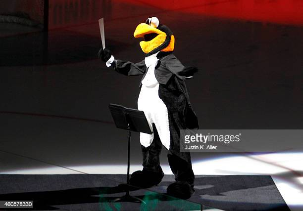 Iceburgh entertains fans during the game against the Vancouver Canucks at Consol Energy Center on December 4 2014 in Pittsburgh Pennsylvania