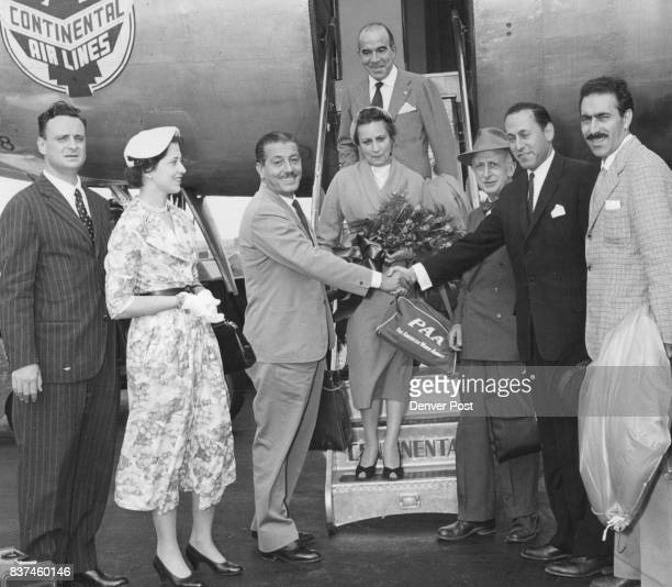 Ice-consul and Mrs. Giulio Bilancioni join with Joseph Ross, president of the Daniels and Fisher Stores Co., in welcoming a group of five prominent...