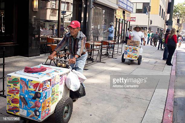"""Ice-Cream men, known as """"paleteros"""", make their way into the Immigration Reform March in Downtown Los Angeles, California. Hundreds march in support..."""
