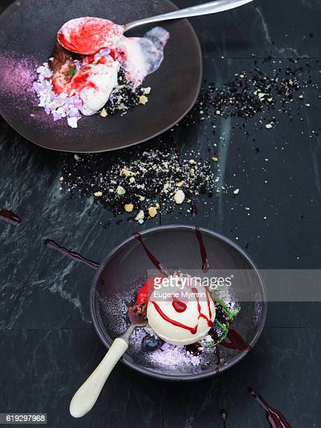 Ice-cream with berries and white chocolate ball