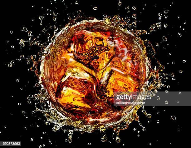 Icecube splashing into cocktail