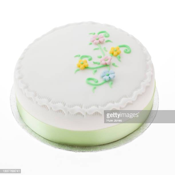 iced birthday cake, blank without a message, isolated on a white background - catering building stock pictures, royalty-free photos & images
