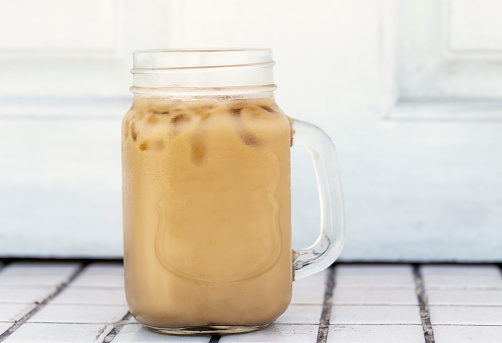 Iced Coconut Latte in Glass Mug - No Straw on White Background - gettyimageskorea