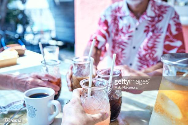 iced coffee, fresh juices and healthy meals are lined up on the table. - chigasaki stock pictures, royalty-free photos & images