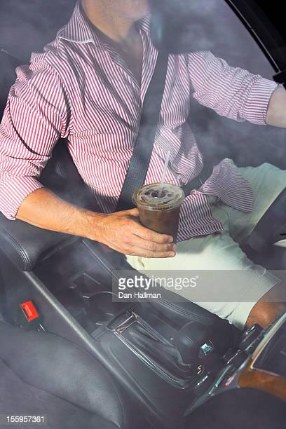 Iced coffee in a car.